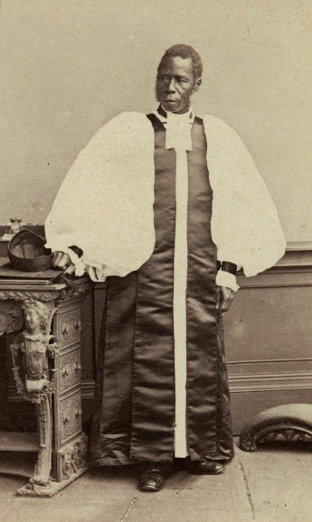 Samuel Ajayi Crowther by Ernest Edwards albumen carte-de-visite, 1864; National Portrait Gallery. Born in Osogun (now western Nigeria), of Yoruban descent, Ajayi was sold into slavery at the age of 13. He was sold several times before landing in the hands of Portuguese traders who purchased him for the transatlantic market. Before it could reach it's destination, the ship he sailed upon was stormed by the British navy's anti-slave trade patrol, the slaves aboard were set free in Sierra Leone. It was here that he became a Christian, he was baptised and named after Samuel Crowther a clergyman in England. In 1827 he became a mission teacher at Fourah Bay Institution founded by the Church Missionary Society to recruit and train Sierra Leoneans into missionary services. He assisted English missionaries in their studies of African languages and studied himself in London, returning to open his own mission in Yorubaland. He is credited with pioneering an early form of Christian-Muslim dialogue to encourage peace. His contributions to evangelization and translation have often been undervalued.  See https://www.npg.org.uk/collections/search/person/mp65321/samuel-ajayi-crowther