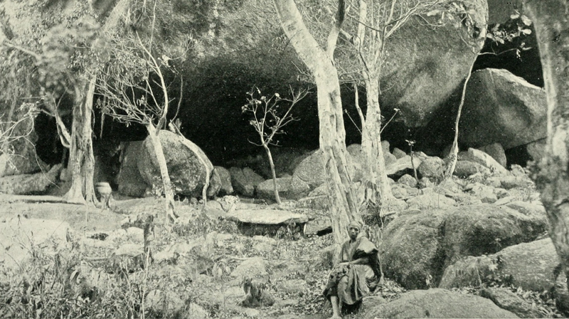 Photograph of Olumo Rock in Abeokuta. A man poses in front.   See Page, Jesse. Samuel Crowther: the Slave Boy Who Became Bishop of the Niger. New York: Fleming H. Revell, 1888, 84.