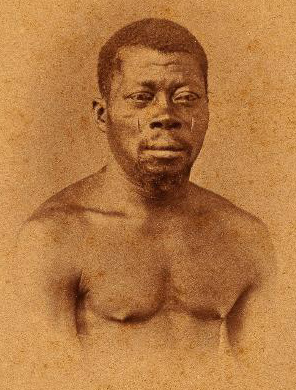 Photograph taken from Christiano Junior. The subject's name, place of birth and time of arrival to Brazil was not recorded. However, the scarifications suggest Oyo affiliation, and it is conceivable this individual arrived to Brazil as a child in the late-1820s and early 1830s, suggesting he was involved in Oyo's collapse.