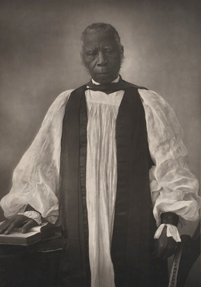 Samuel Ajayi Crowther (c.1809–31 December 1891), was a Yoruba linguist and the first African Anglican bishop in what is now Nigeria. Born in Osogun (in what is in Lanlate, Oyo State, Nigeria), he and his family were captured by Fulani slave raiders when he was about twelve years old. Crowther was freed from slavery at a coastal port by the Royal Navy's West Africa Squadron, which was enforcing the ban against the Atlantic slave trade. The liberated peoples were resettled in Sierra Leone. In Sierra Leone, Ajayi adopted an English name of Samuel Crowther, and began his education in English. He adopted Christianity and also identified with Sierra Leone's then ascendant Krio ethnic group. He studied languages and was ordained as a minister in England, where he later received a doctoral degree from Oxford University. He prepared a Yoruba grammar and translation of the Anglican Book of Common Prayer into Yoruba, also working on a Yoruba version of the Bible, as well as other language projects. This photograph was taken in 1867.  See https://www.lambethpalacelibrary.org/content/lambethconference.  See https://en.wikipedia.org/wiki/Samuel_Ajayi_Crowther
